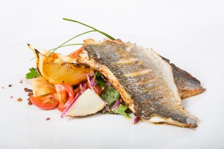 garnish: Fried white fish fillet with vegetable garnish Stock Photo