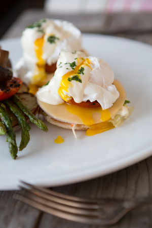 Benedict eggs with grilled asparagus, mushrooms and potatoes Reklamní fotografie