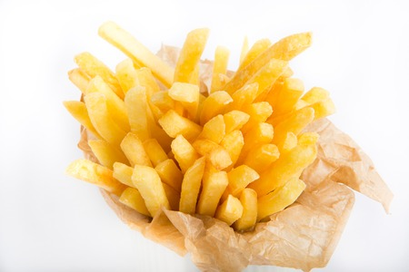 nosh: French fries in a paper wrapper on a white background