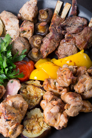 sorts: Different sorts of grilled meat served on a big cauldron