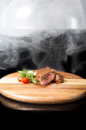Prepared beef steak on a wooden board Stock Photo