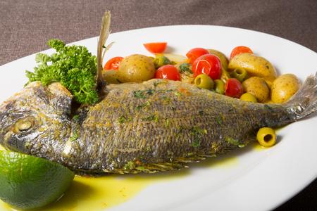 dorado fish: Grilled dorado fish served with potato garnish