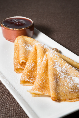 served: Freshly baked pancakes served with sweet jam