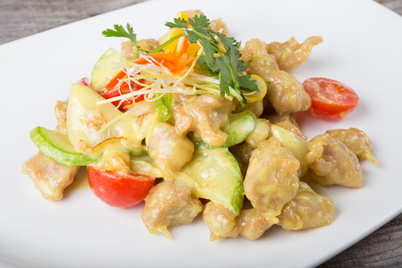 curry dish: Chicken curry dish with herbs and vegetables