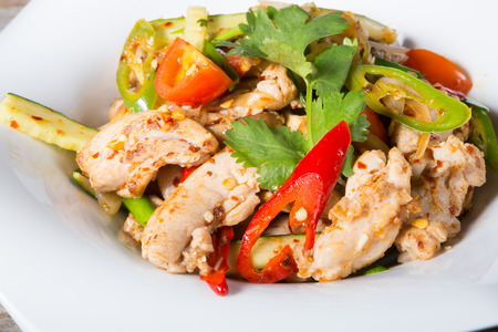 Asian stir-fried chicken with vegetables and spices Stock Photo