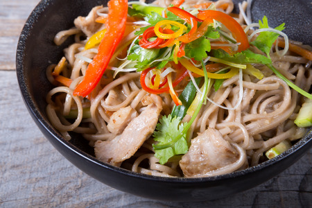 wok: Soba wok noodles with meat and herbs Stock Photo