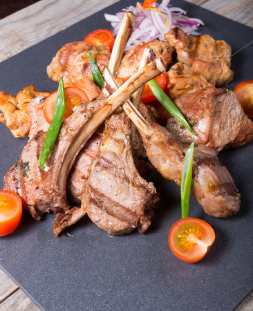 sorts: Different sorts of grilled meat served with vegetables