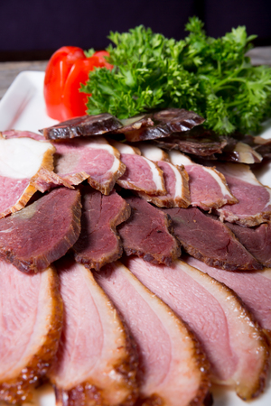Different sorts of parma ham meat on wooden tray Stock Photo