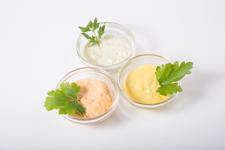 sauces: Three different sauces on a white background