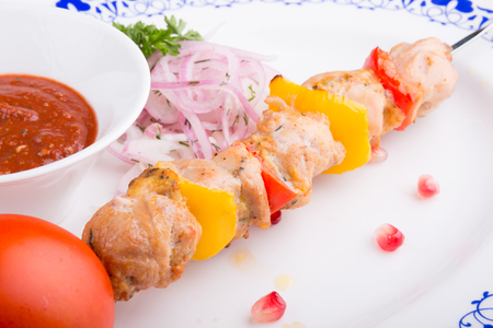 kebob: Grilled chicken meat on a skewer with vegetables Stock Photo