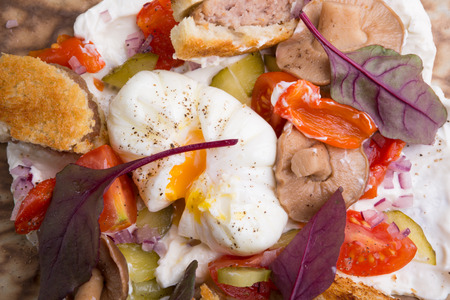 benedict: Benedict egg with salad and small burgers Stock Photo