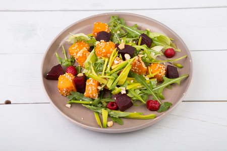 Pumpkin salad dish served on wooden table Stock Photo