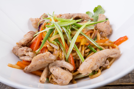Asian noodles wok with chicken and vegetables
