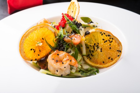 Elegant asian seafood salad served with shrimps and oranges Stock Photo - 98110051