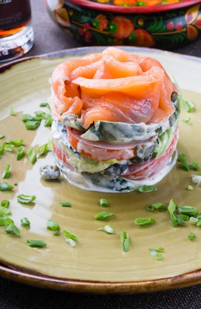 Salted salmon salad served with leek on a plate