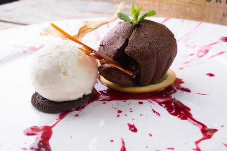 Chocolate brownie cupcake served with ice cream