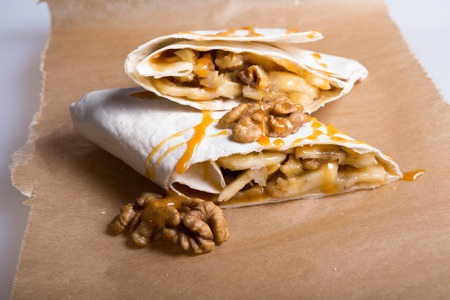 Sweet wrap stuffed with nuts, fruits, marshmallow and syrup