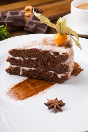 Slice of chocolate cake decorated with gooseberry Archivio Fotografico - 112473624
