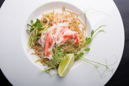 Elegant white crab meat noodles salad served with lime