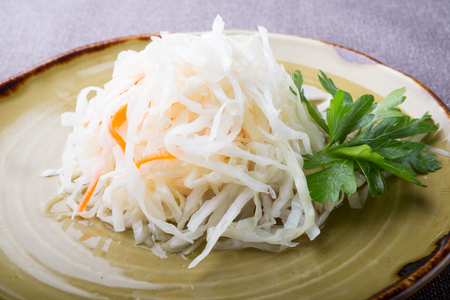Salted and marinated cabbage sauerkraut salad served with parsley