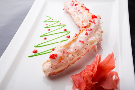 Steamed crab leg meat served with caviar and ginger Stock Photo