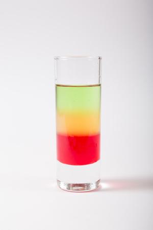 Alcohol glass shot on a white. Reklamní fotografie