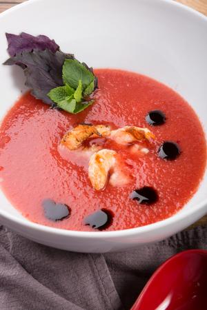 Spanish tomato gazpacho soup served with basil leaf Zdjęcie Seryjne