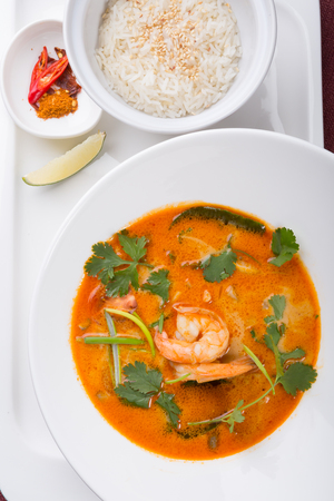 Thai tom yum soup served with rice and chili Фото со стока