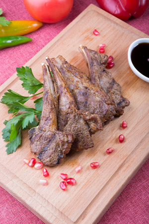 Fried and grilled lamb meat served with pomegranate sauce