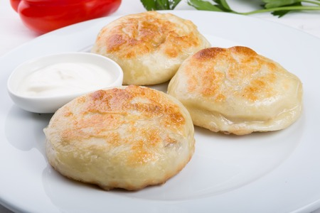 Fried buns stuffed with meat Stock Photo