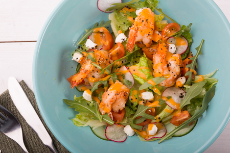 Grilled shrip salad with arugula and different vegetables