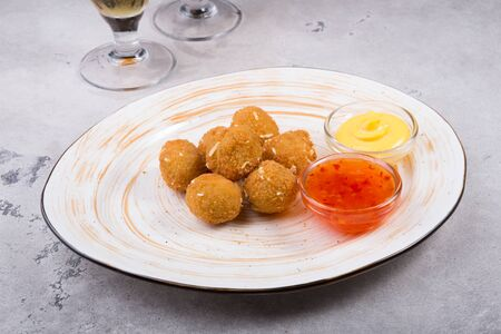 Fried cheese balls as beer snack served on a plate