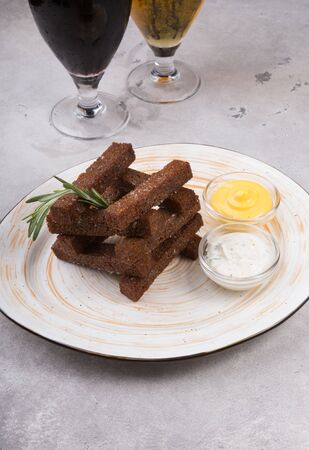 Black rye bread croutons served on a plate