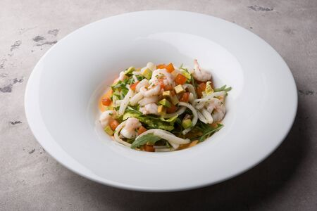 Freshly cooked seafood salad served on a white plate Archivio Fotografico