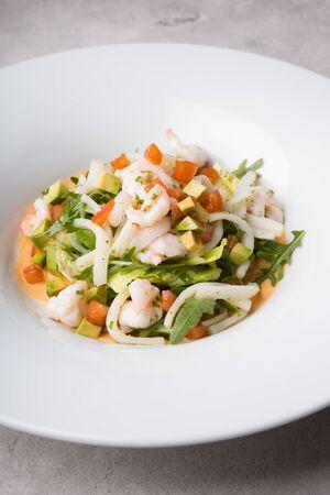 Freshly cooked seafood salad served on a white plate Zdjęcie Seryjne