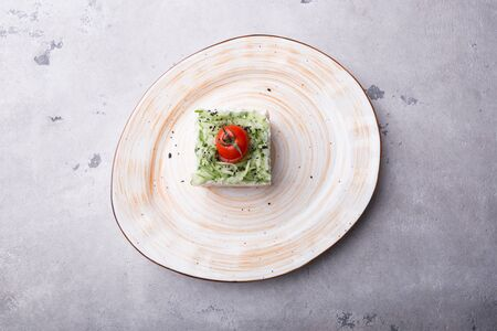 Russian smoked salmon salad served on a plate