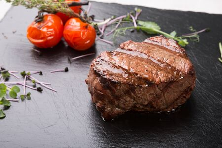 Prepared beef steak served with herbs and spices