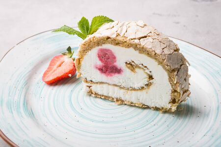 Slice of ice cream roll cake served with strawberry and mint 스톡 콘텐츠
