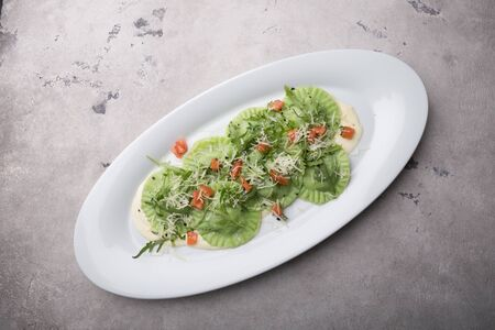 Fresh green ravioli served with parmesan cheese