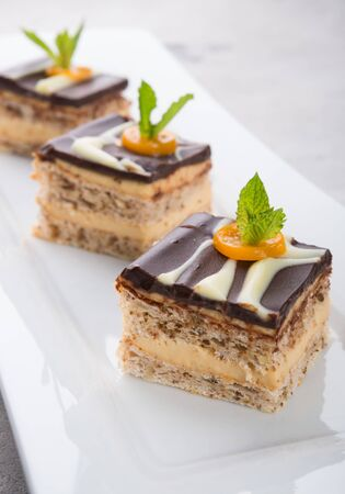 Three pieces of chocolate cakes decorated with mint leaves Stock fotó