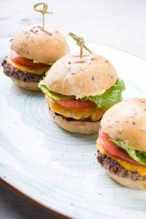 Elegant mini burgers served for dinner on a plate