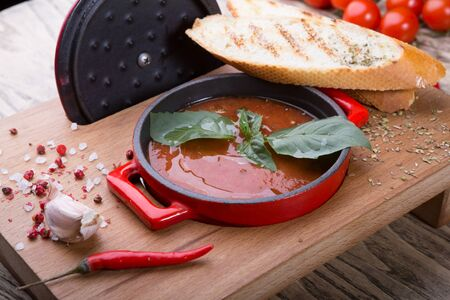 Red tomato cold gazpacho soup served with croutons