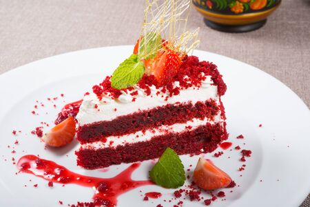 Red velvet piece of cake served with strawberries