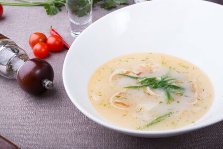 White seafood fish creamy soup with leek
