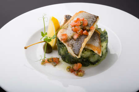 Fried fish fillet with spinach and potato garnish