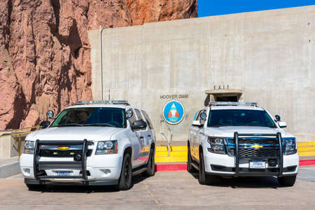 Two Chevrolet SUVs white base model service vehicle wearing U.S. government plates registered to the Department of the Interior parked at Hoover Dam - Las Vegas, Nevada, USA - 2020