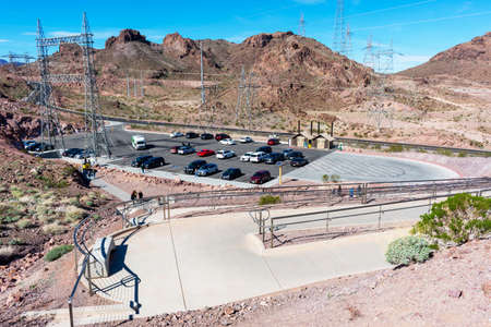 Elevated view of half empty outdoor parking area of Mike O'Callaghan - Pat Tillman Memorial Bridge from the top of wheelchair accessible disabled access ramp - Las Vegas, Nevada, USA - 2020