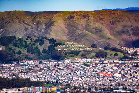 Aerial view of South San Francisco with a historic sign on a hillside of San Bruno Mountains overlooking the city - South San Francisco, CA, USA - 2020 에디토리얼