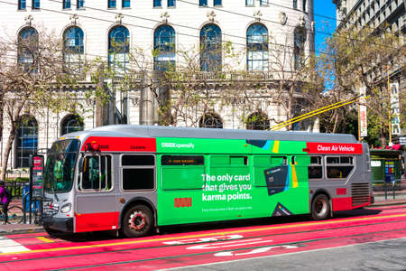 Expensify advertisement on trolley bus exterior is building brand awareness. Expensify is a company that develops expense management system for personal and business - San Francisco, CA, USA - 2020