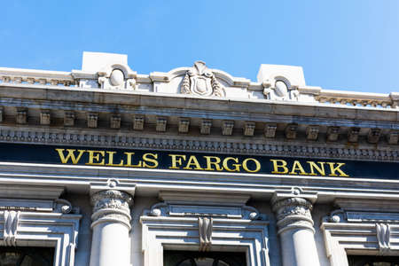 Wells Fargo Bank sign on historic headquarters complex. Wells Fargo and Company is an American multinational financial services company - San Francisco, California, USA - 2020